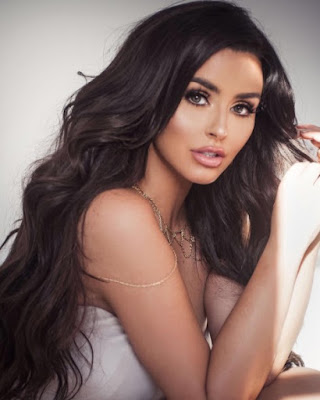 Abigail Ratchford appears in long black hair and nice red lips