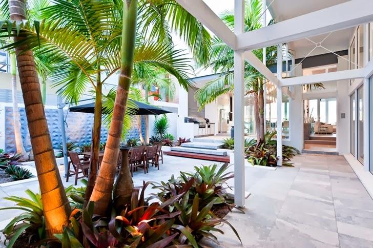 Backyard terrace in Coastal Oasis landscape project by Urban Exotic