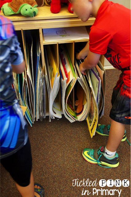 students organizing and clean up big books