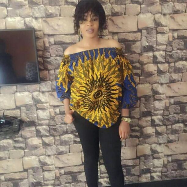 Off shoulder ankara top on black trousers