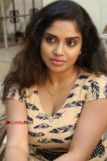 Telugu Actress Karunya Chowdary Stills in Short Dress at ATM Not Working Press Meet  0154.jpg