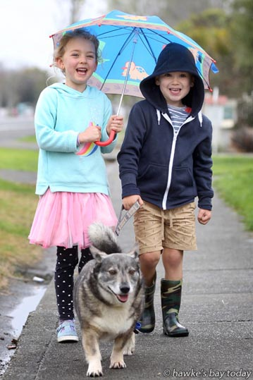 L-R: Lucy Strong, 5, Arnold Trowbridge, 4, cousins, out for a walk with Marco the Dog, on Gloucester St, Napier, in very light rain, drizzle, weather. photograph