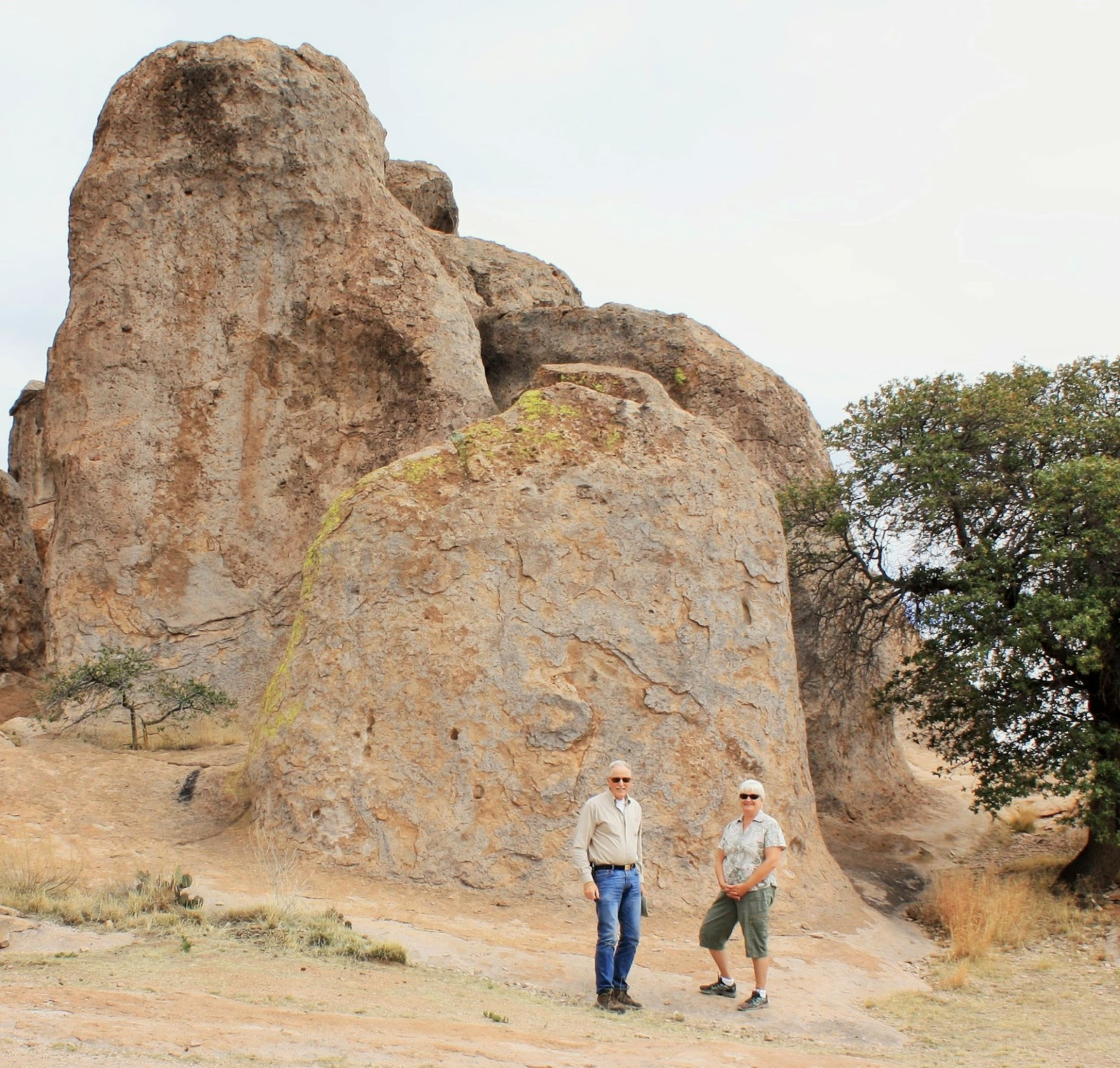 Jeff and Joan pose in front of a large boulder