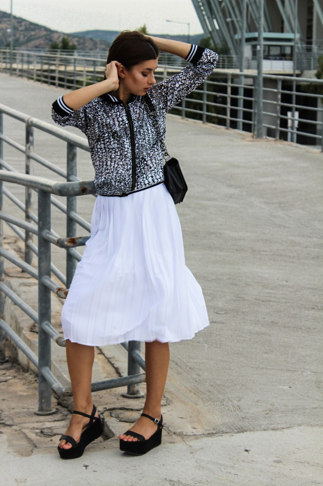 a394f9a1270 A printed bomber jacket with sporty details rocks this white pleated  skirt.Pleated midi skirts will ''rule'' the world for the next season in  lots of ...