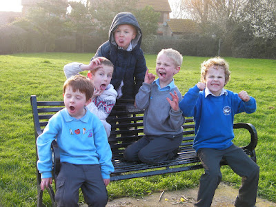 group of schoolchildren pulling faces