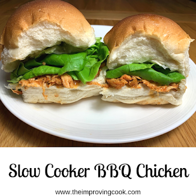 Two soft white rolls filled with slow cooker BBQ chicken and lettuce