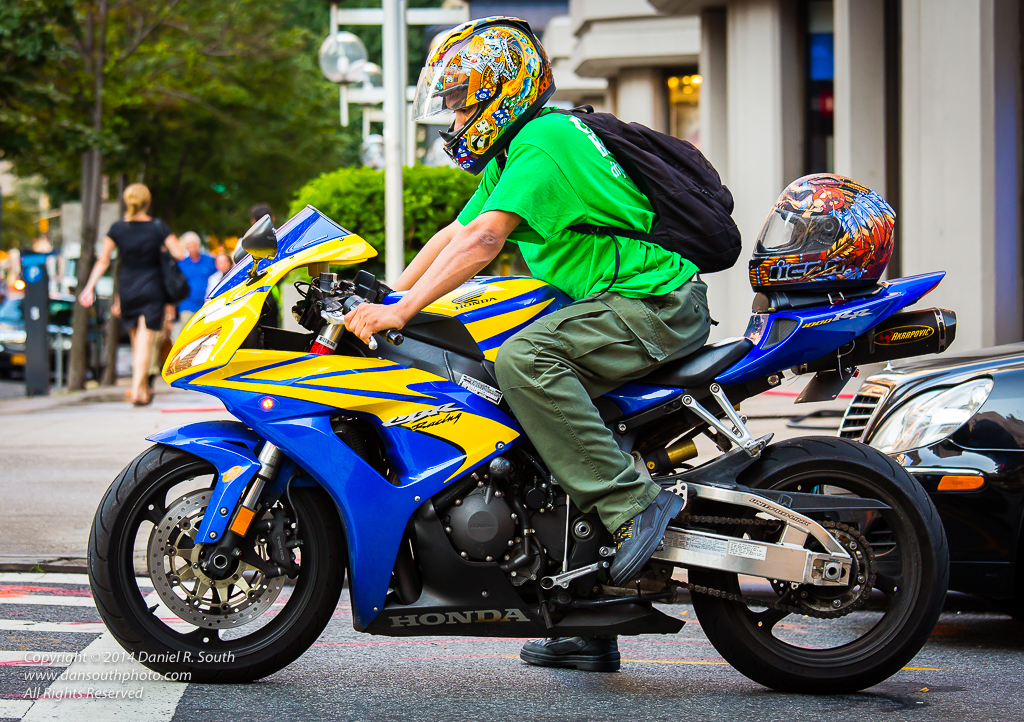 a photo of a colorful motorcycle and rider in new york city