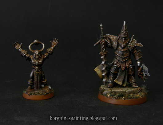 Photo showing the final comparison of the miniatures - the one from the tutorial on the left and the converted Stormcast Eternal on the right.