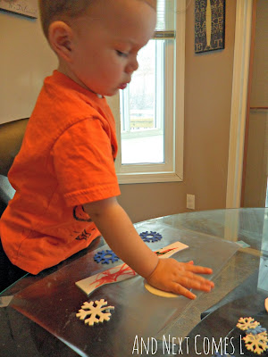K working on his sticky winter collage from And Next Comes L
