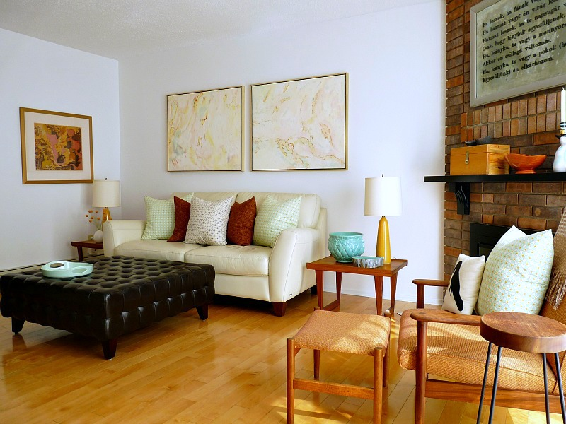 Living room with cream sofa and teak accents