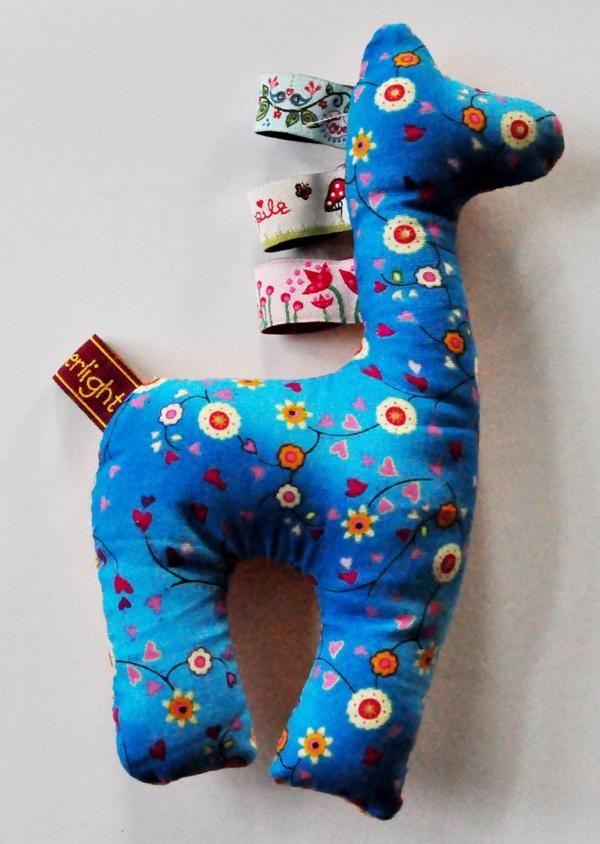 Schlaufen-Giraffe von Seitenstiche - amberlight-label