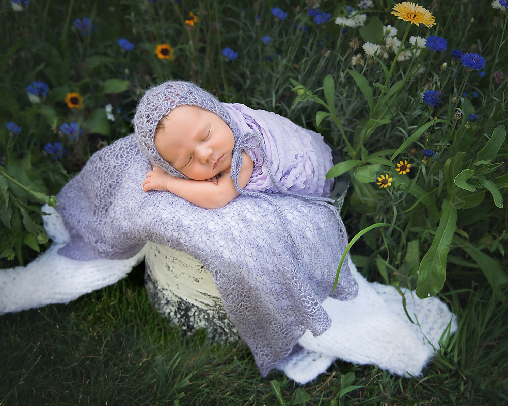 Outdoor Newborn Photo in a garden by Wigglebug Photography DeKalb, Sycamore Newborn Photographer