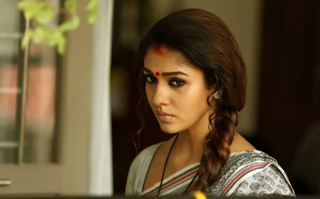 Nayantara Actress photos in Puthiya Niyamam malayala movie