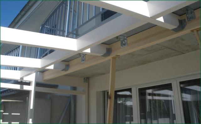 podwieszenie dachu ogrodu zimowego pod balkon