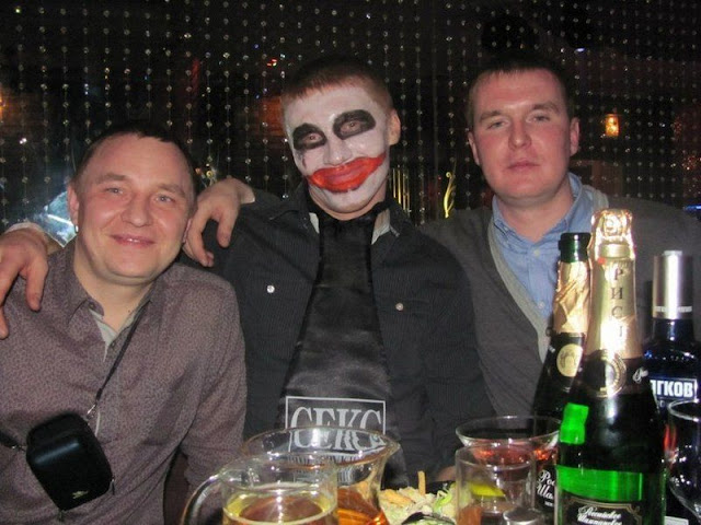 A drunk has painted his face