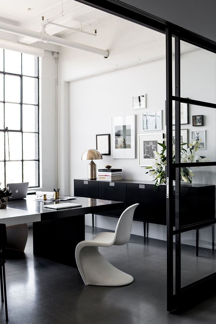 Dark offices with a serious focus-down-to-work vibe | Photo by Laure Joliet via Dwell