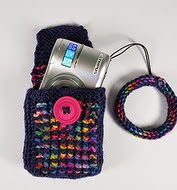 http://www.ravelry.com/patterns/library/camera-pocket