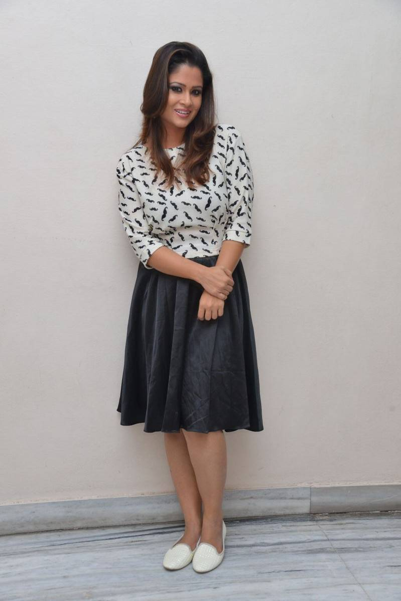 TV Anchor Shilpa Chakravarthy Hot Photos In Black Mini Skirt At Audio Launch