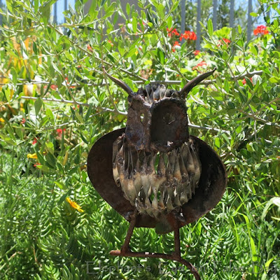 Metal owl garden art