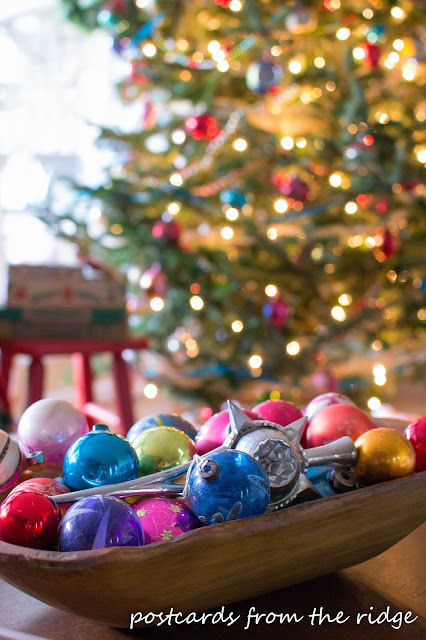 colorful old mercury glass ornaments in a wooden bowl