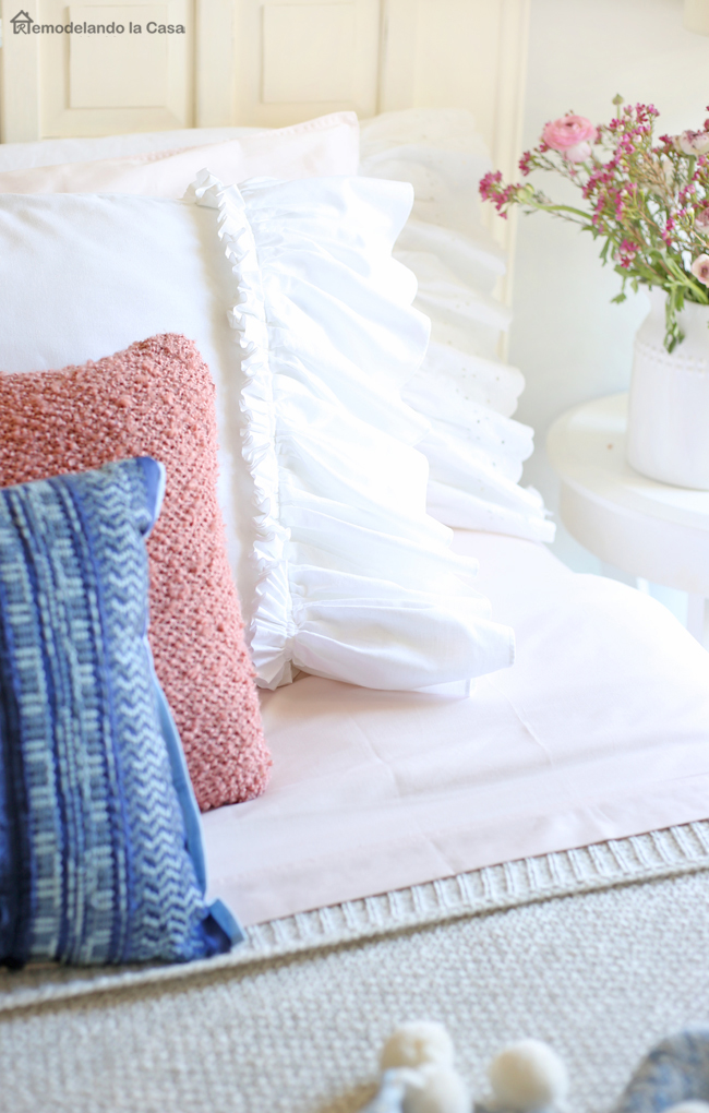 bed with pillow cases made from curtains