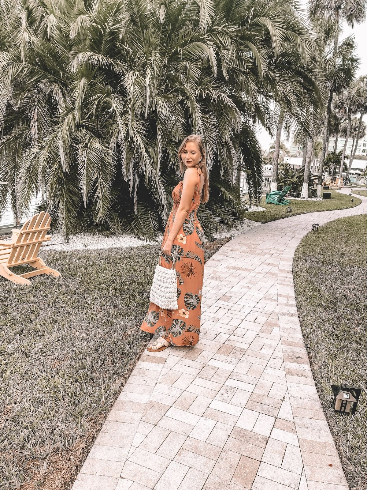 Tampa blogger Amanda Burrows is wearing a palm tree maxi dress. She is carrying a small crochet purse from Shoptoska Pop Up Shop.