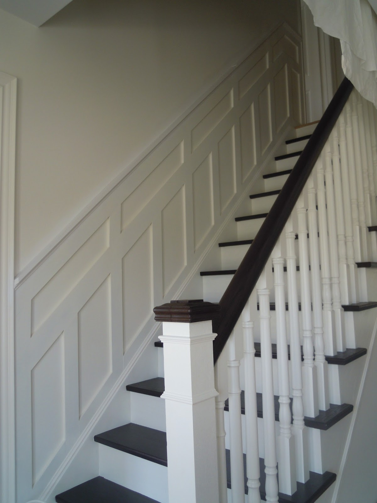 Paneled Staircase White Wood Transformation With Wainscoting