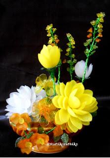 http://manikcantik2unik.blogspot.co.id/2013/07/bunga-bunga-keranjang-aqutas-manik-dll.html