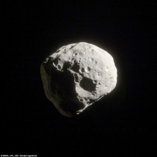 Irregular small moon Epimetheus visible from a distance of 104.500km. This month has a radius of about 130 km, while some of the craters on its surface has a size of 30 km more.