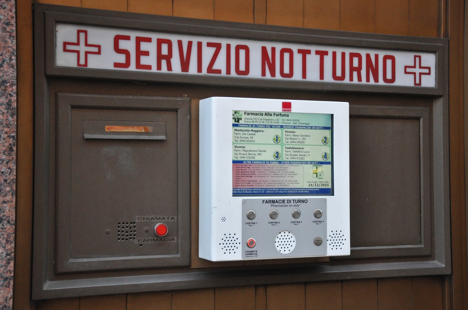 A screen displaying information about pharmacies on duty, Vicenza, Veneto, Italy