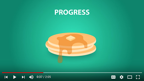 still frame image from video, featuring illustrated image of a stack of pancakes.  Text: progress