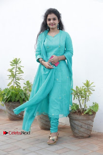 Tamil Actress Preethi Stills in Green Salwar Kameez at Kuzhalosai 2nd Anniversary Fund Raising Event  0040.jpg