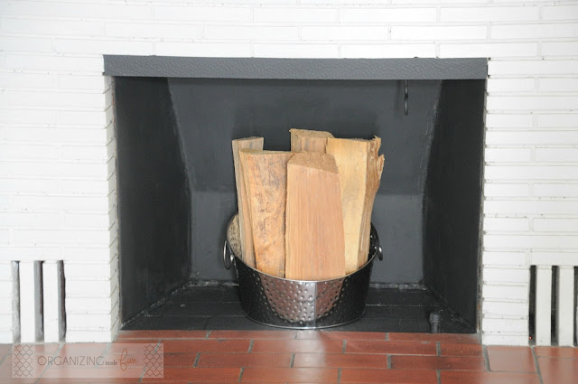 Insert in fireplace painted all black :: OrganizingMadeFun.com