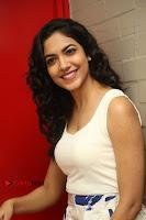 Actress Ritu Varma Stills in White Floral Short Dress at Kesava Movie Success Meet .COM 0109.JPG