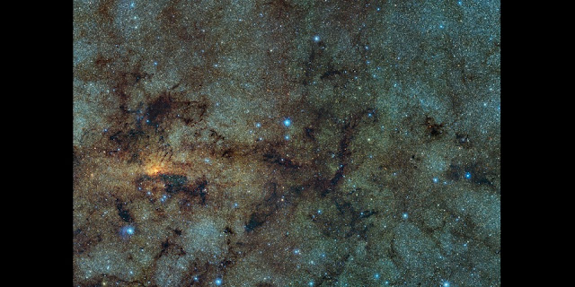 This image, captured with the VISTA infrared survey telescope, as part of the Variables in the Via Lactea (VVV) ESO public survey, shows the central part of the Milky Way. While normally hidden behind obscuring dust, the infrared capabilities of VISTA allow to study the stars close to the galactic centre.  Within this field of view astronomers detected several ancient stars, of a type known as RR Lyrae. As RR Lyrae stars typically reside in ancient stellar populations over 10 billion years old, this discovery suggests that the bulging centre of the Milky Way likely grew through the merging of primordial star clusters.  Credit: ESO/VVV Survey/D. Minniti