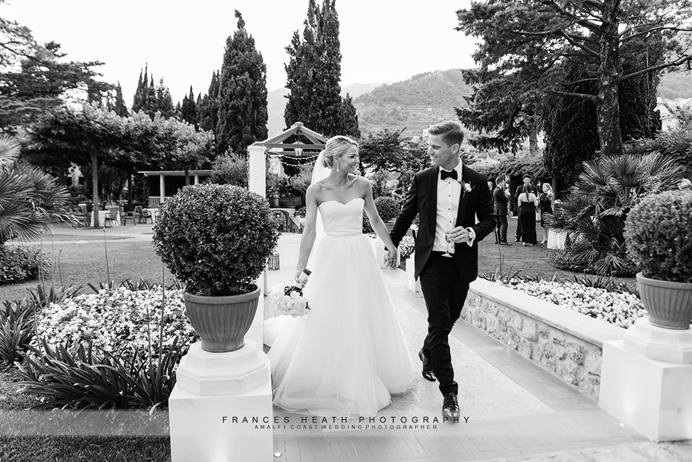 Bride and groom walking in Villa Eva gardens