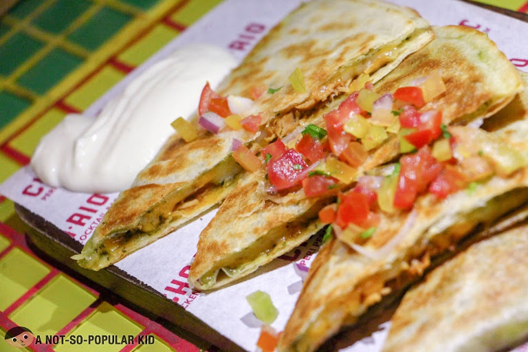 Chichario's quesadilla with pesto sauce
