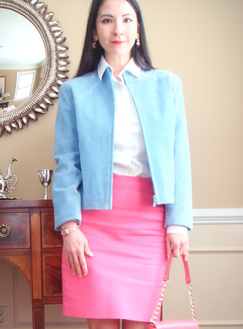 Wearing bright pink pencil skirt, white button down and blue suede jacket. Photo cut off at knee length.