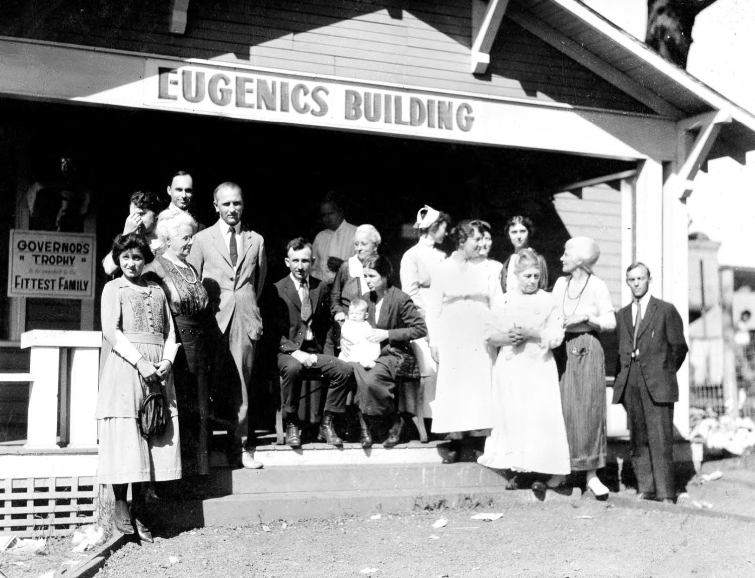 Winning family of a Fitter Family contest stand outside of the Eugenics Building (where contestants register) at the Kansas Free Fair, in Topeka, KS.