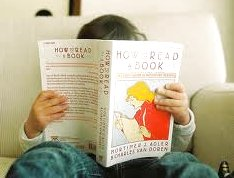 Child reading Mortimer Adler's How to Read a Book