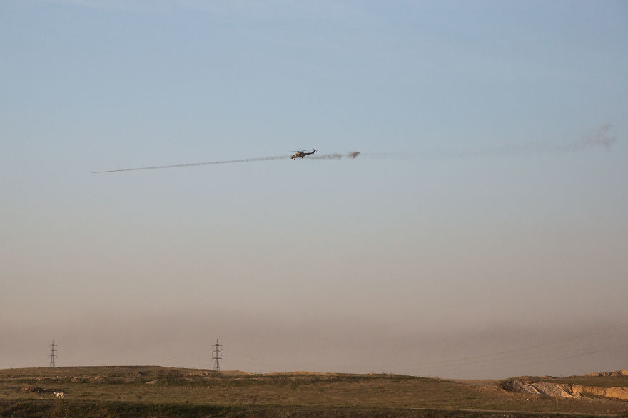 Powerful Heart-Breaking Pictures Of The Battle Of Mosul - A helicopter gunship fires at Islamic State positions