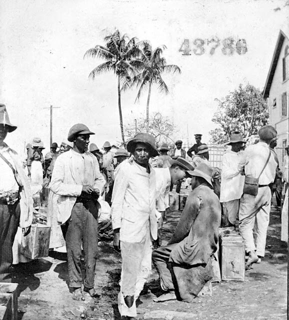 Crowd of men, coconut oil at market. Georgetown. 1922. Georgetown, Guyana, South America