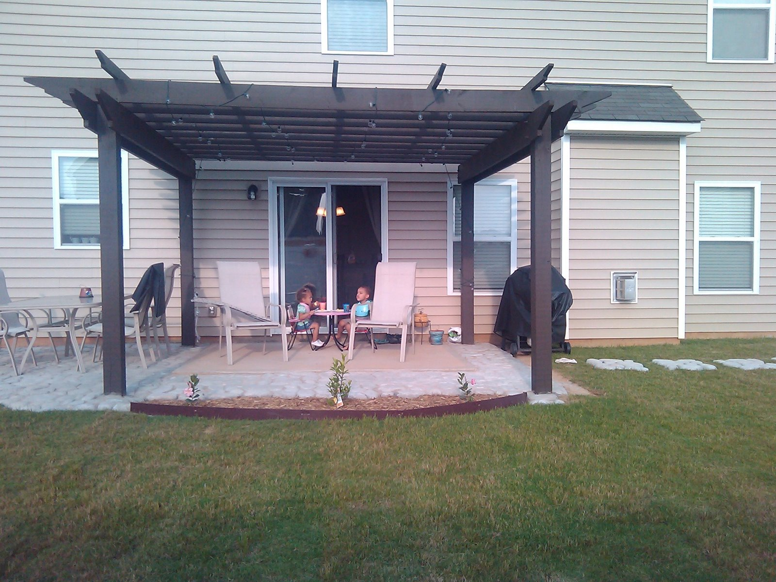 Perfect Here Is The Finished Product, For Now, We Stained The Pergola And Made A  Flower Bed On The Front Of The Patio.