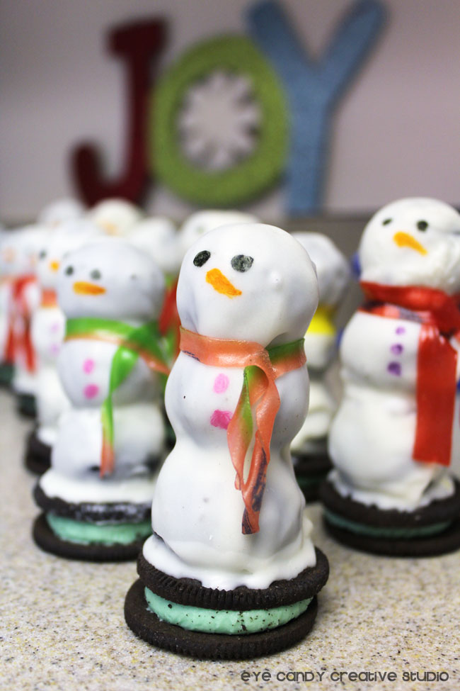 wrapping fruit roll ups around snowman for scarf, oreo cookie ball snowman