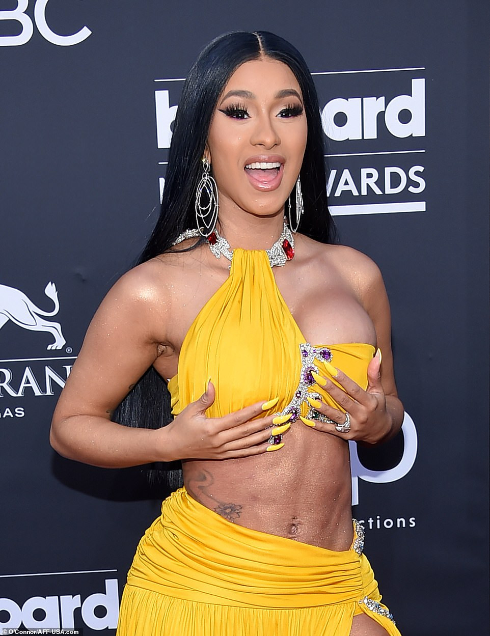 Cardi B Unveils Her Entire Back Tattoo With Bright Pink: CARDI B's Outfit To The Billboard Music Awards Leaves