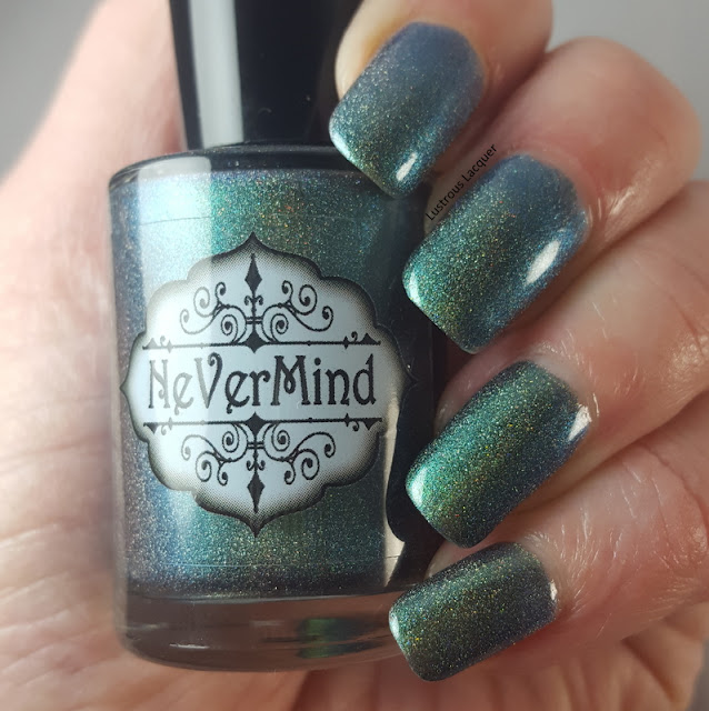 Deep-moss-green-to-Emerald-green-duochrome-nail-polish-with-scattered-holographic-glitter