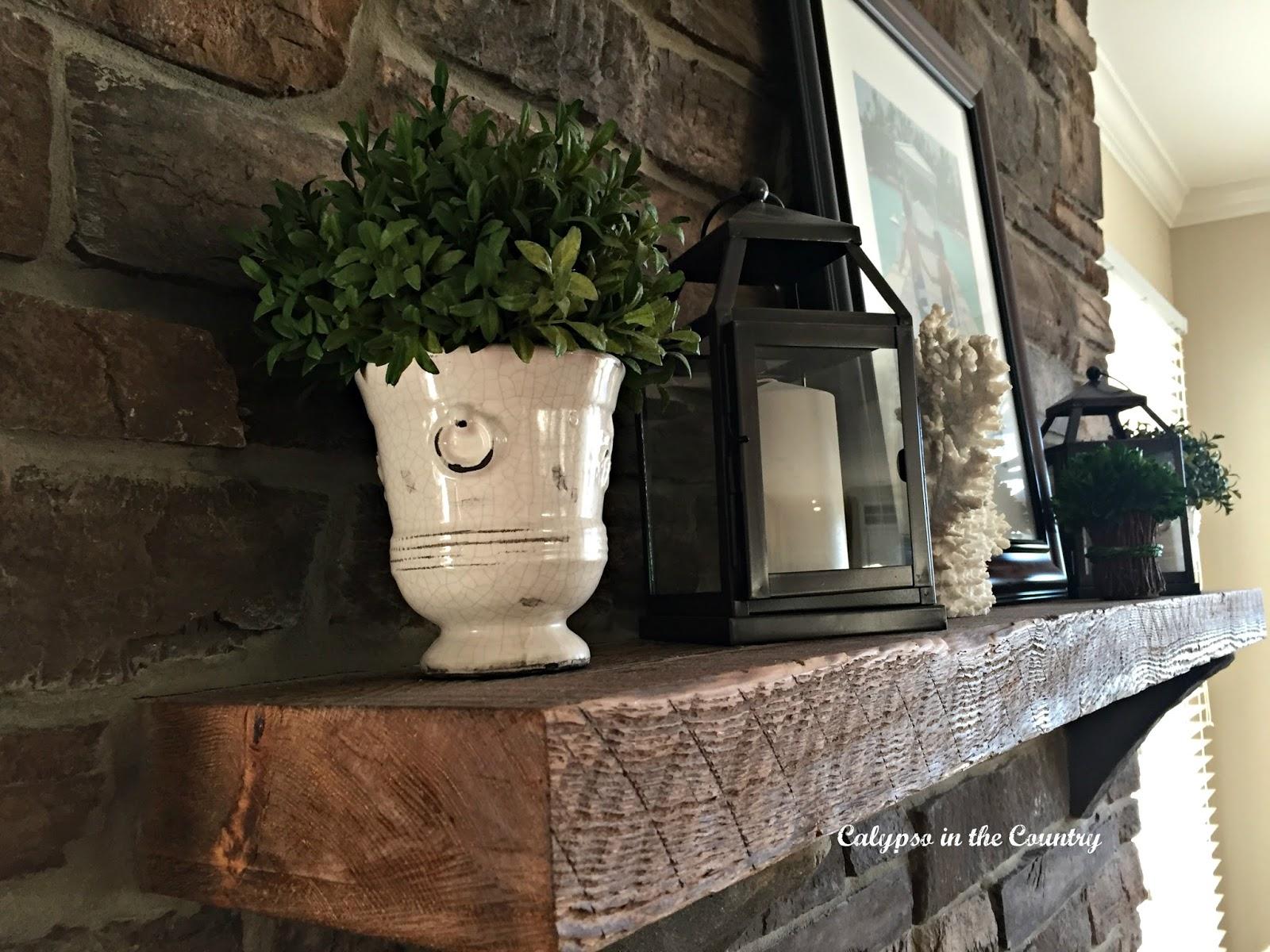 Rustic mantel on stone fireplace