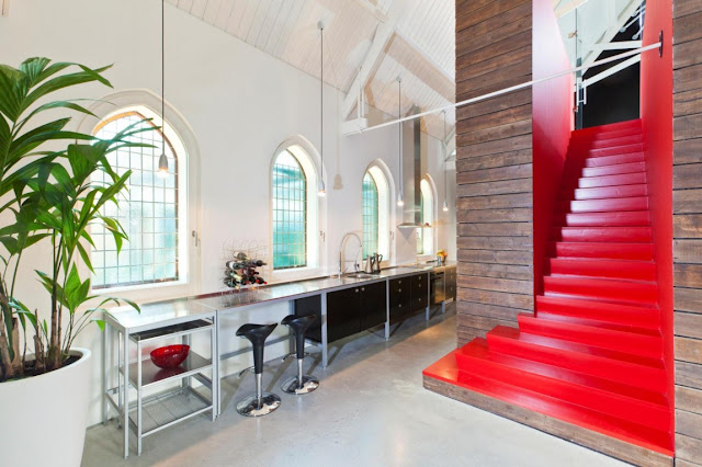 Picture of the kitchen and red staircase to the mezzanine floor