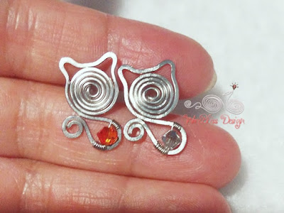 Wire wrapped cat studs with Swarovski Crystals