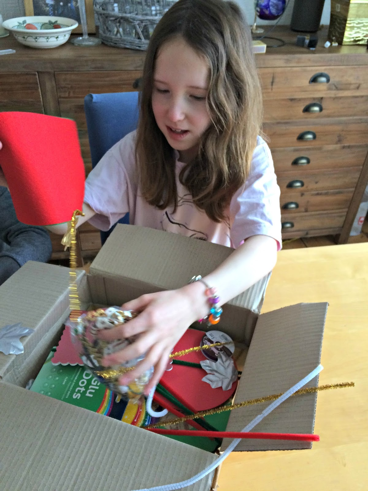 Caitlin opening the Bostik craft box